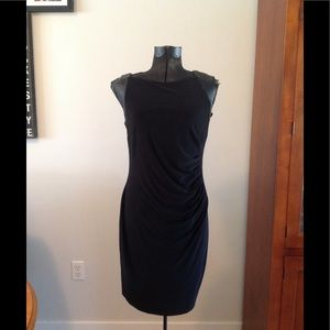 Black sleeveless dress with leather trim